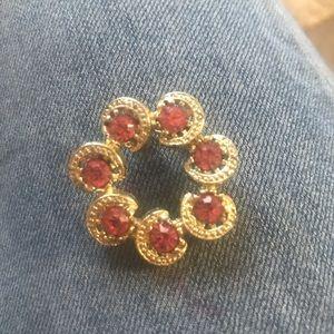 Vintage gold tone brooch with fuchsia rhinestones